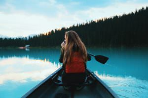 Woman in canoe navigating